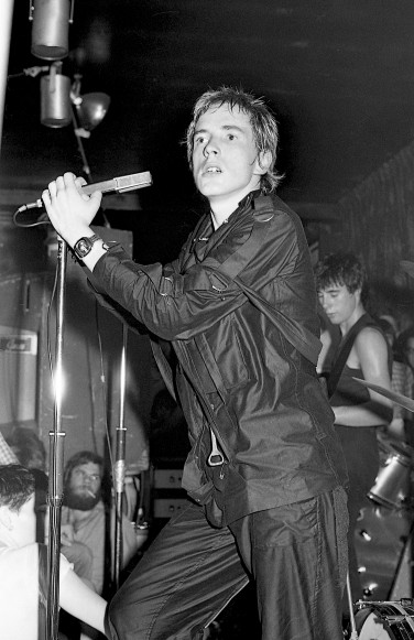 John Lydon performing with The Sex Pistols at the 100 Club Punk Special (1976) by Barry Plummer