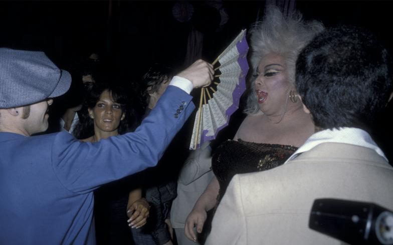 Elton John fans Divine at Studio. Photographer: Ron Gallela